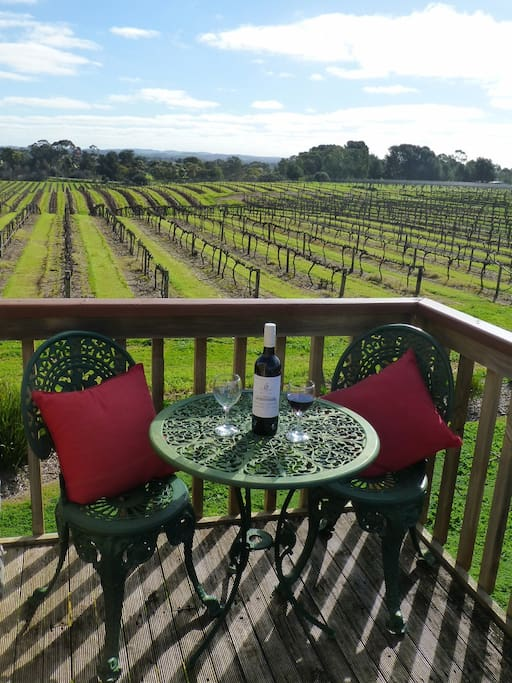 Relax on the balcony of the Coach House overlooking the vineyards
