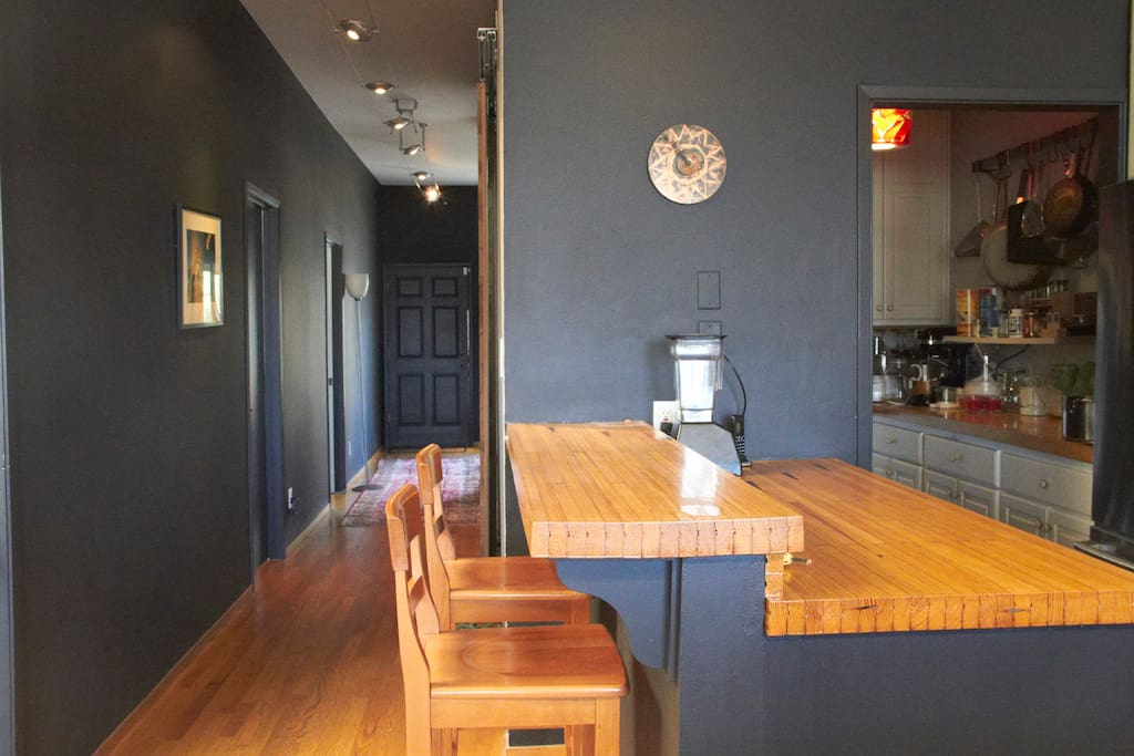 KItchen, pantry and hallway: the kitchen counters are made from a repurposed old bowling lane