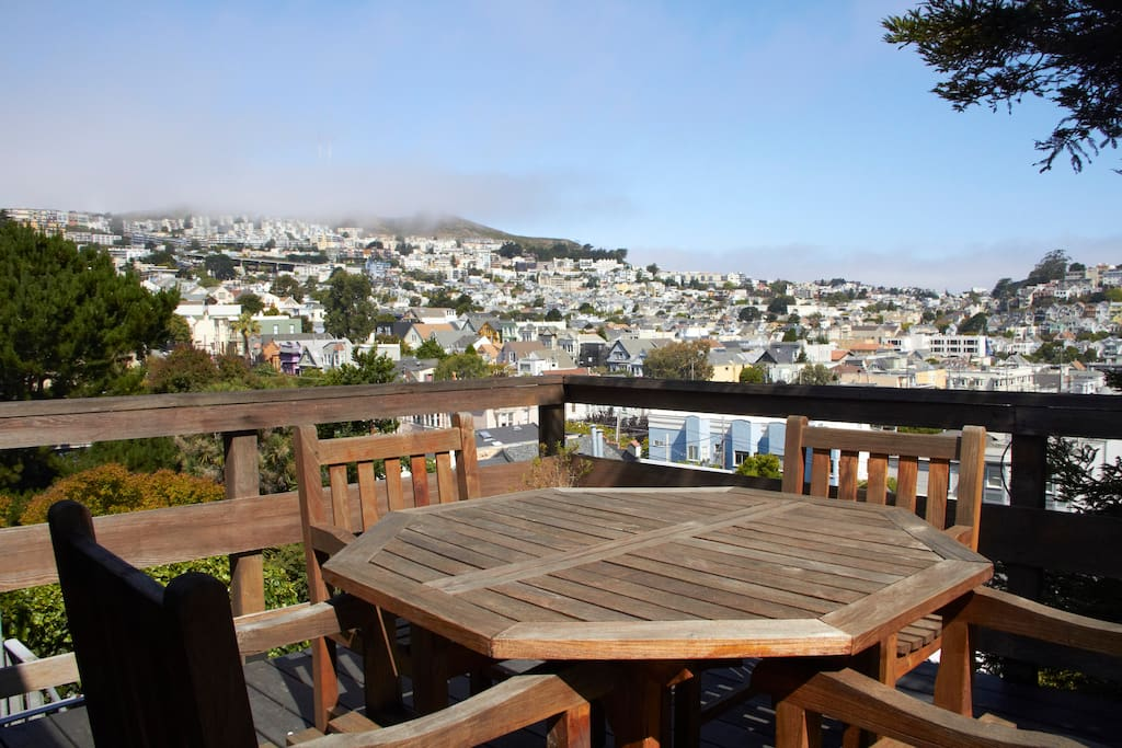 Deck with a view! Pictured here are Twin Peaks with the fog rolling in and Noe Valley and 24th Street below. View the city lights by night.