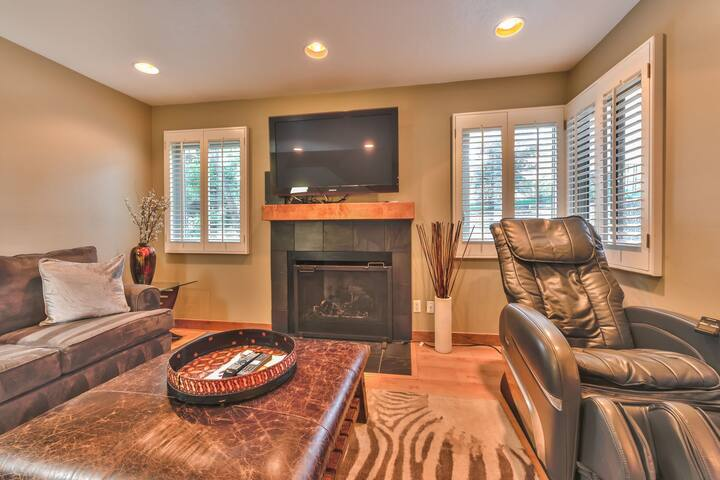 """Living Room with a Massage Chair, a Gas Fireplace and a 50"""" Samsung TV"""