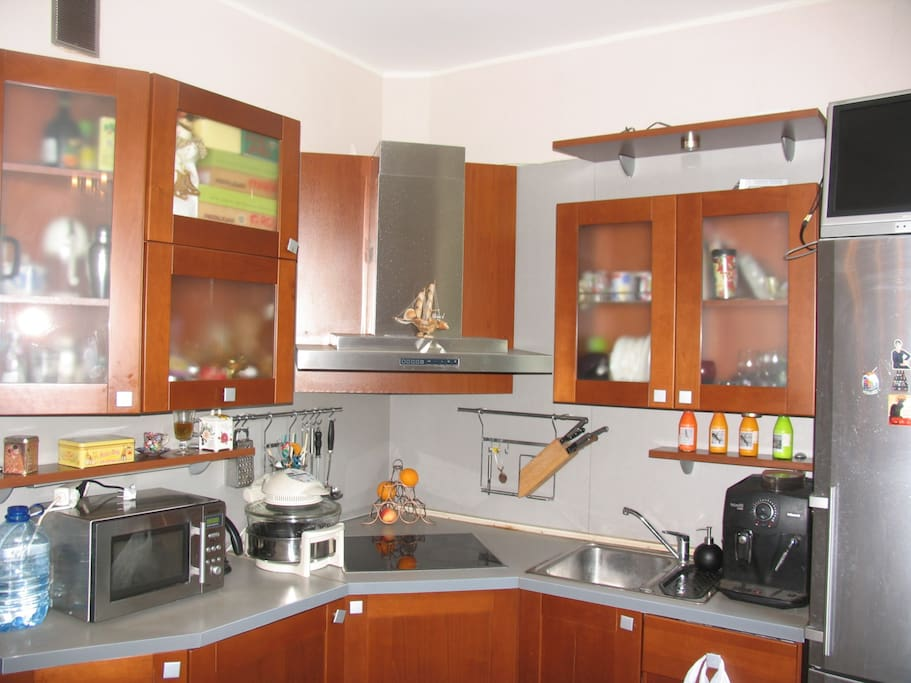 kitchen is equipped with everything you might need: washing machine, grill, microwave, toaster, blender, cutlery etc