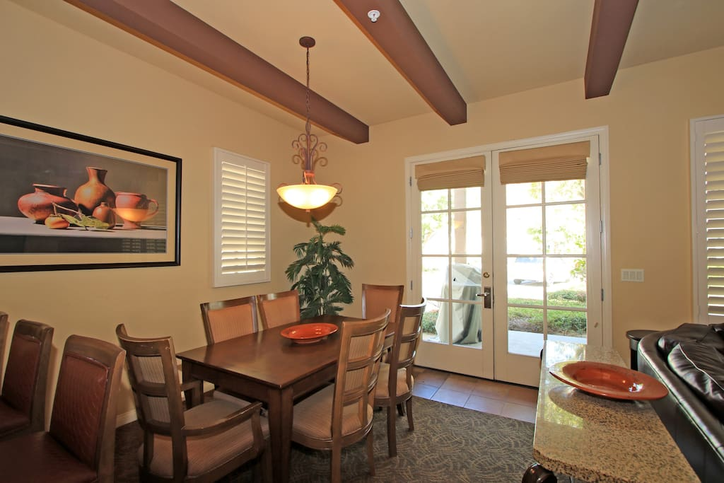 Dining table with french doors opening to patio