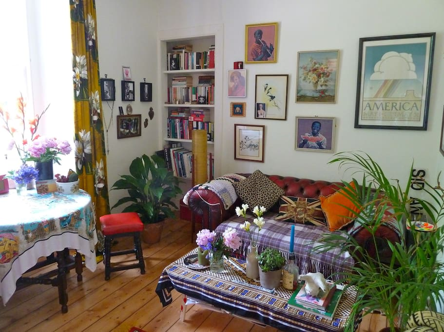 Comfortable lounge filled with fresh flowers, books and artwork.