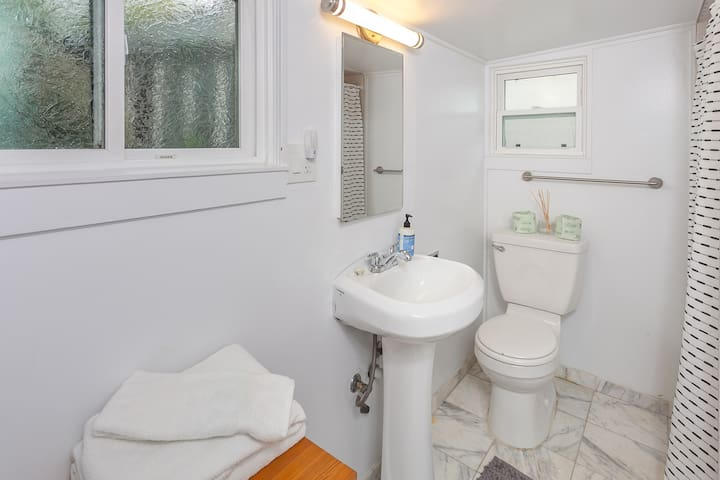 Roomy master bath with pedestal sink and recently remodeled shower.