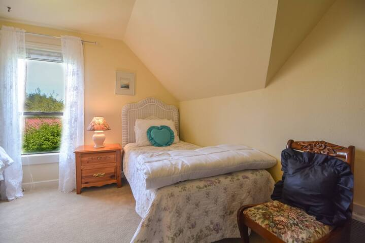 Twin bed in upper bedroom south wing