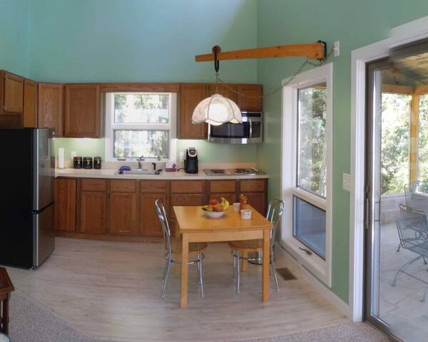 Kitchen with cook top, microwave, refrigerator w/freezer, toaster oven, keurig coffee maker.