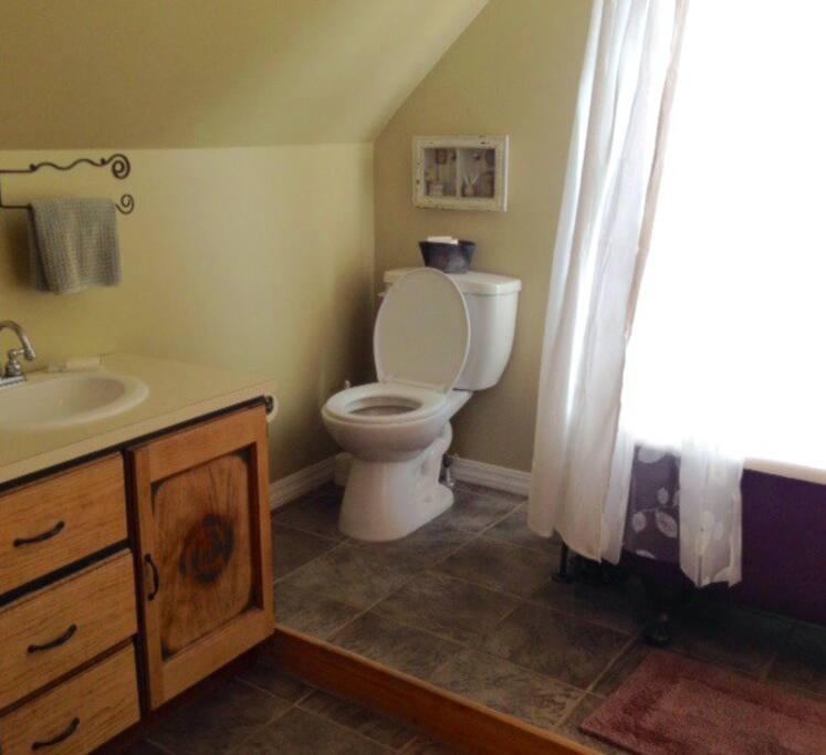 Claw foot tub in shared bathroom.