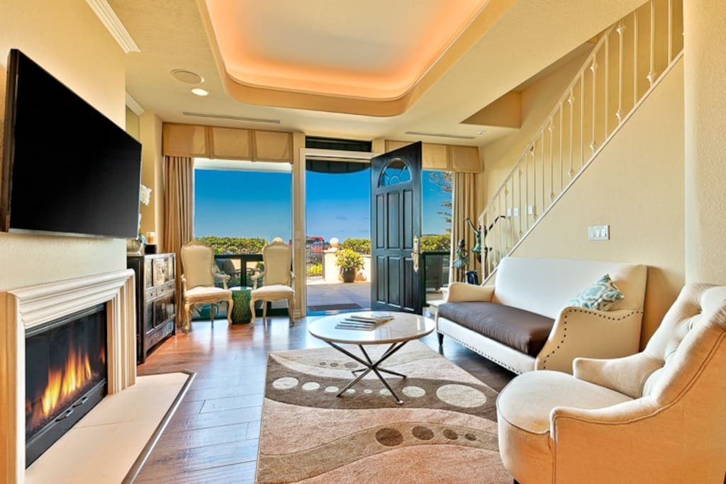 1st Floor Living Room with Fireplace, Flat Screen TV and Ocean Views.