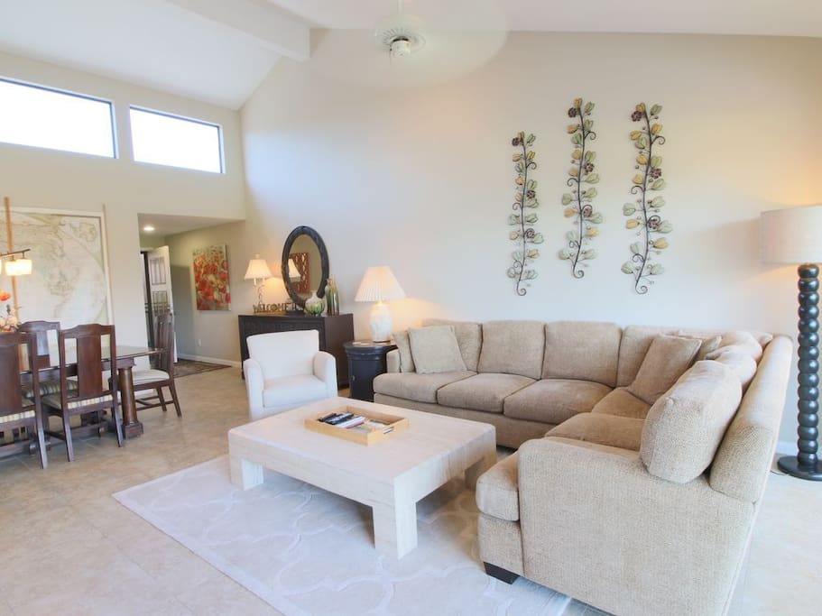Inviting family room with goose down filled chenille sectional, travertine coffee table and Crate and Barrel chair.