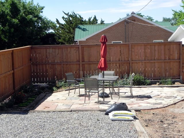 The outside, landscaping and yard are works in progress, but this rock patio is just outside the kitchen door.  Eat and relax in the great outdoors.