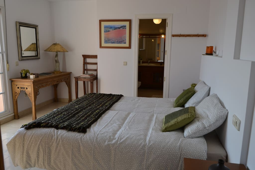 Room 1 has direct access to the terrace and private bathroom with shower and bathtub.
