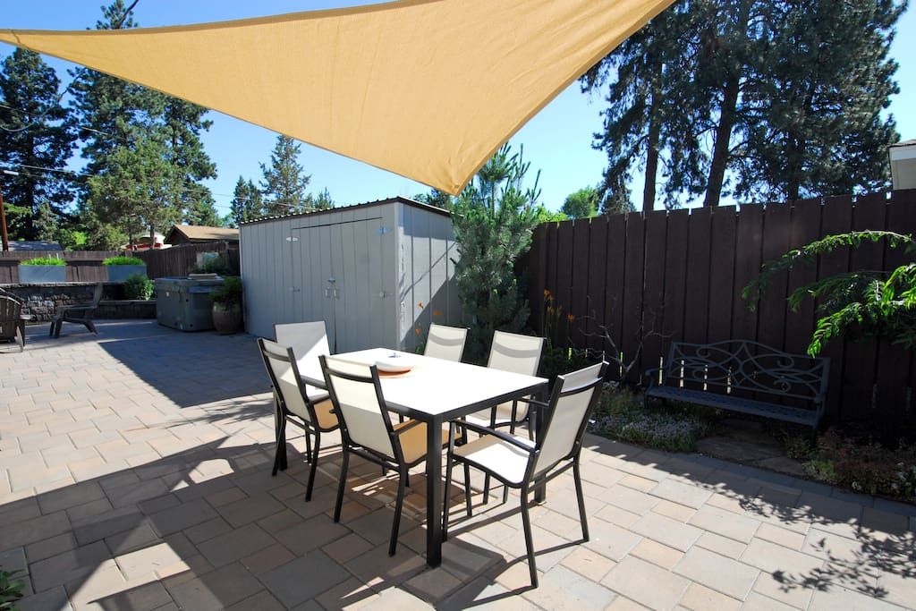 Private paver patio off the dining room includes Weber barbecue, patio table, firepit and 6 person hot tub.