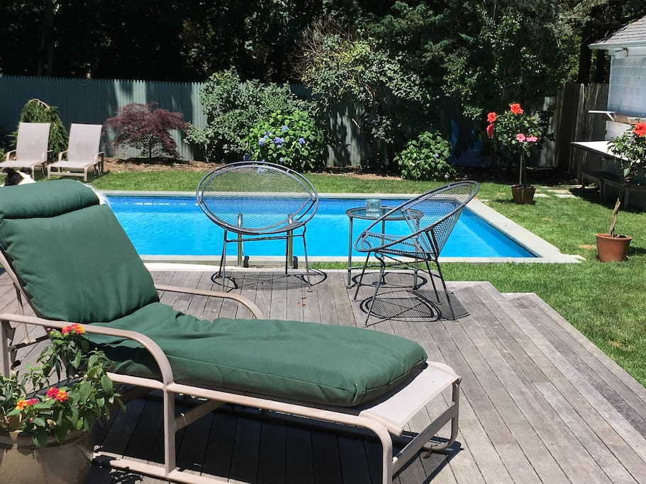 Deck leads to garden and pool and Webber BBQ