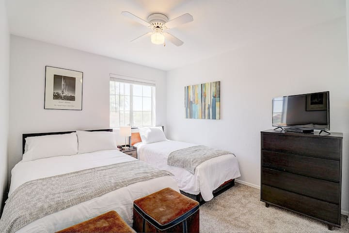 guestroom 3 with a full bed and twin bed. sharing nightstand and a chest of drawers.  two soft stools for gaming or sitting.  tv and dvd player for your use.