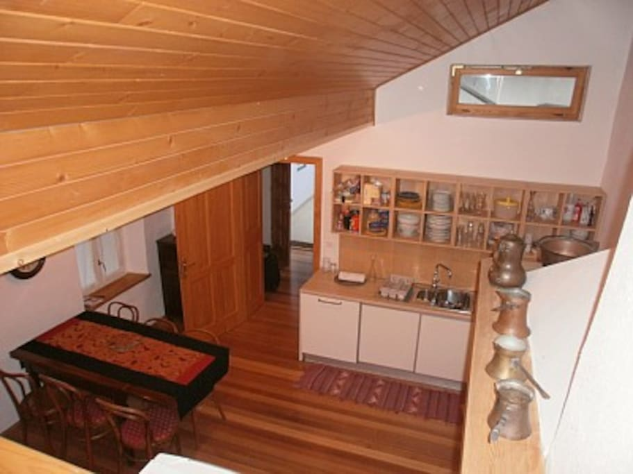 Kitchen and dinning room- view from the stairs to the 1st floor