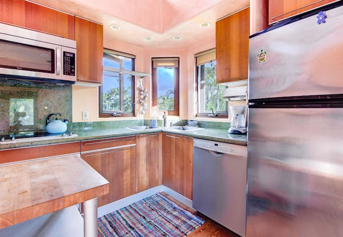 Kitchen  with  granite counters,European cabinets and appliances