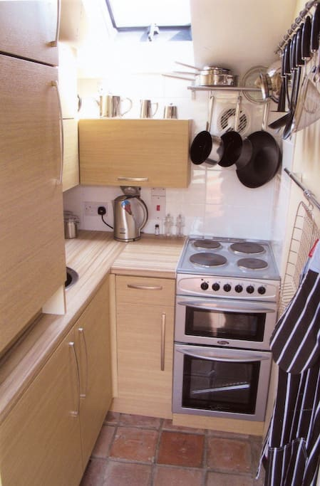 Fully fitted kitchen, including cooker, microwave, washer dryer, fridge with freezer compartment. All kitted out with top quality cookware, china and cutlery, kettle, good quality knives and utensils. We hope we've thought of everything!