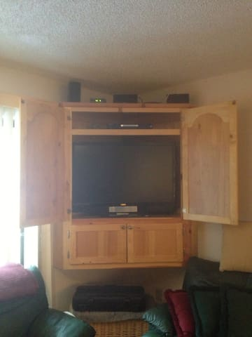 Flat screen TV with Apple TV and sound system