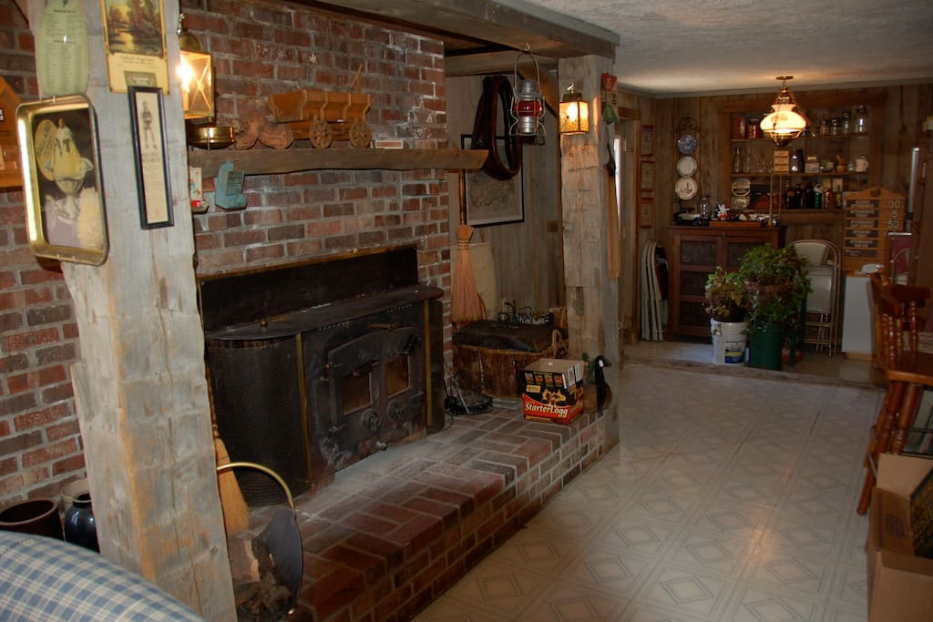 Vacation Cottage Recreation room w/ fireplace, wet bar, overlooking Spring Creek. Can sleep two on sofa (twin size) beds.