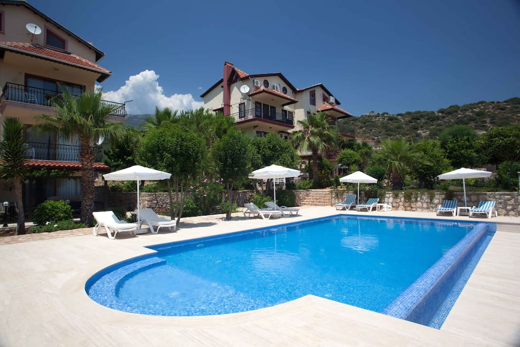 Our large pool with terraces, lots of sunbads  and umbrellas