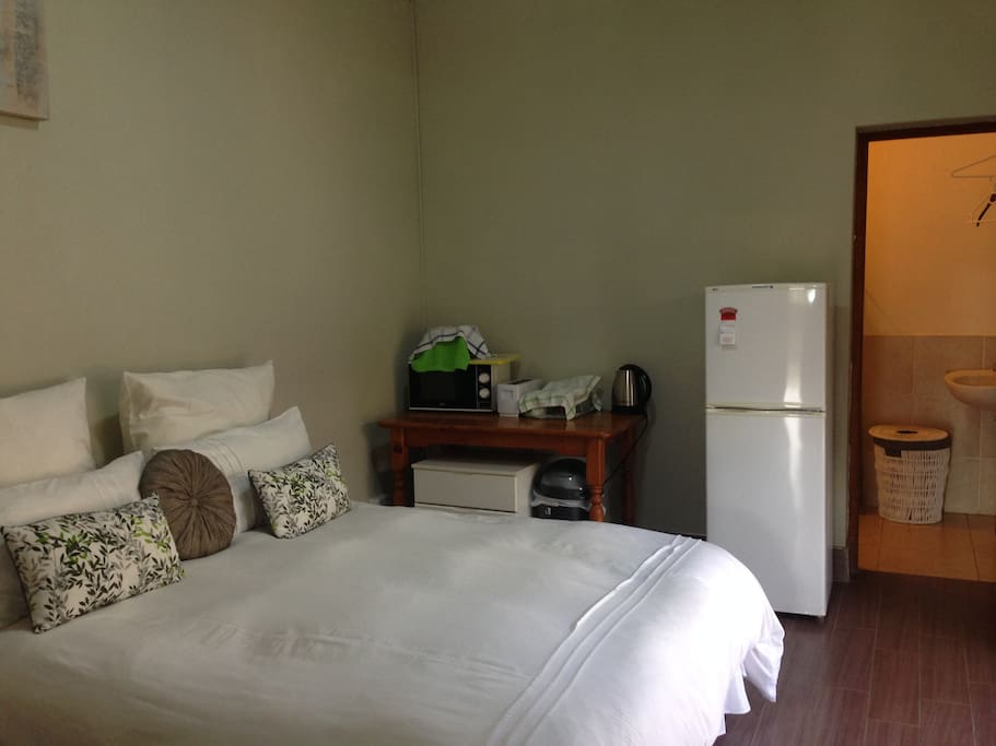 Queen Size Bed, Microwave, Fridge with small freezer, Kettle and Toaster.  Shower En-Suite.