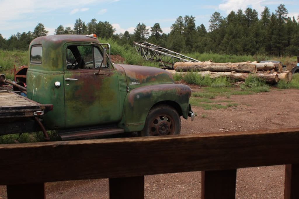 Old farm truck, stacked pine trunks, and a reclaimed steal tower waiting to be brought into life and action.