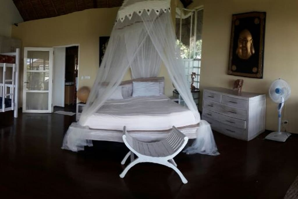 room upstairs with king size bed and large wooden solid bunk bed