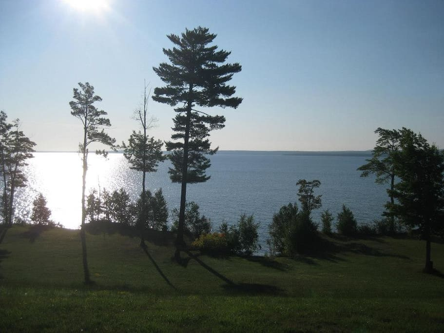 A unique feature of this property is the panoramic high bluff view of Lake Superior. The view is unobstructed spans of water from Second Sand Beach, Pequaming, to the shoreline of L'Anse, and is bordered by the forests of the Huron Mountains. Relax or din