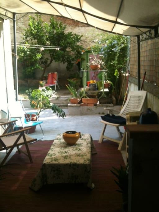 View of the garden from the living room. This is the covered part of the garden where you can sit even if it rains.