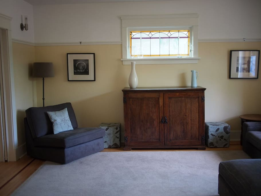 Living room. Period features including stained glass windows
