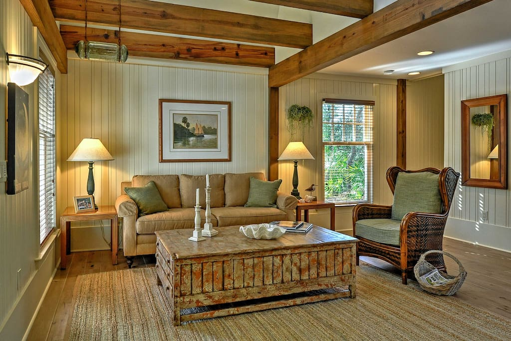 Unwind in the open-concept living space, featuring exposed wood-beam ceilings.