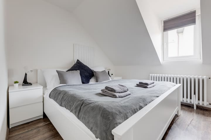Bedroom with king size bed and workspace