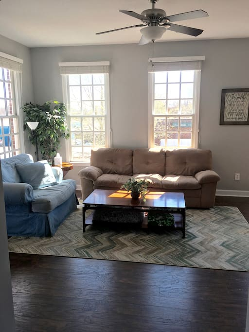 Large living room with lots of natural light!  Couch is very comfortable and can easily be another sleeping spot.