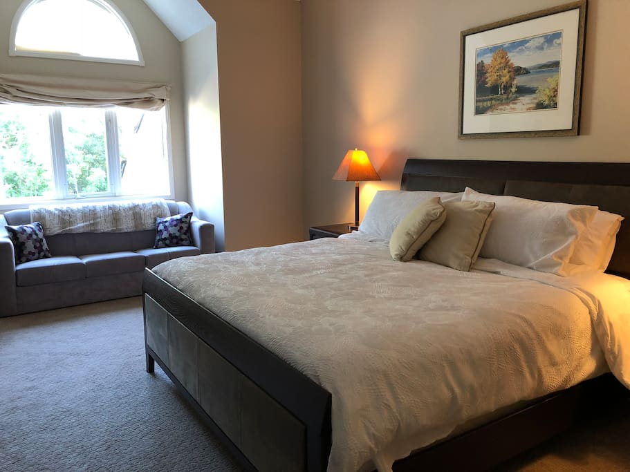 The upstairs bedroom has a king bed and a pullout couch. All linens included.