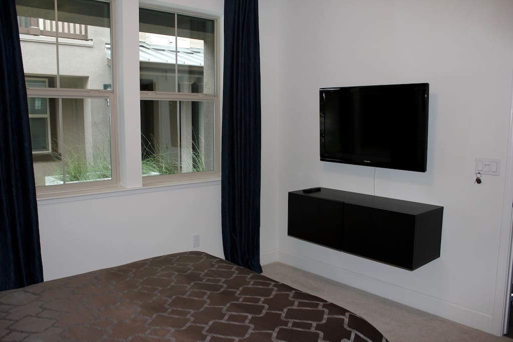 Stream Netflix, Hulu, HBO, and most cable channels with Apple TV on a wall mounted 40-inch TV.