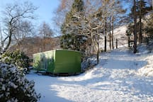 The caravan in the snow - you can see the fells behind