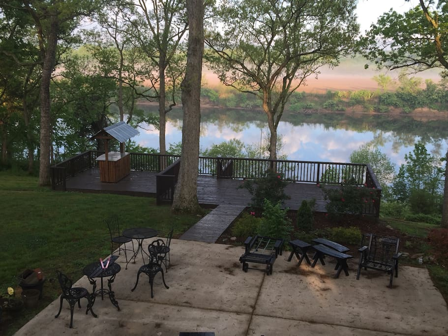 Outdoor living areas include two lower deck levels with tiki bar,  large patio, and covered patio area. There also is a rear deck in the second level. There is a gas grill, exterior lighting  and heater for outdoor enjoyment.