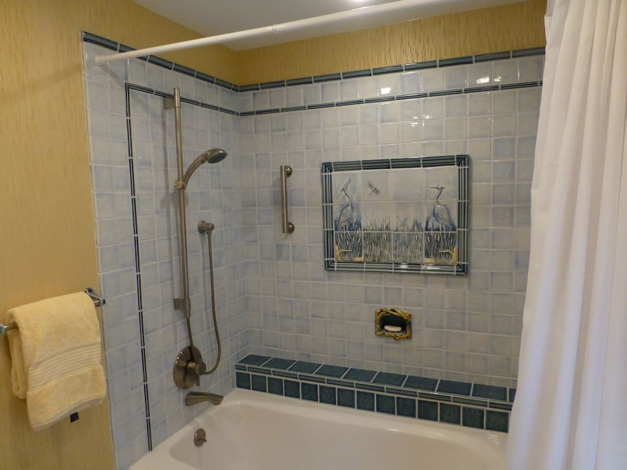 Blue-heron motif on hand-painted tiles in luxurious master bath
