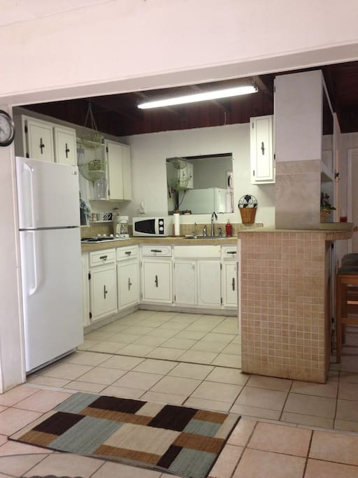 Enjoy your own private Kitchen equiped with a Full Refridgerator, full large oven/broiler, microwave, mini broiler/toaster over, coffee maker, toaster, kitchen linens, soaps. This picture is from sitting in the dining nook looking into kitchen.