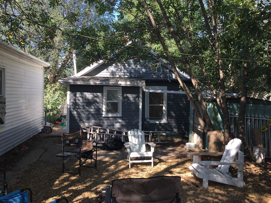 Large shaded rear yard, small fires welcomed. Ask about renting the modern RV trailer in the rear for an additional 5 people.