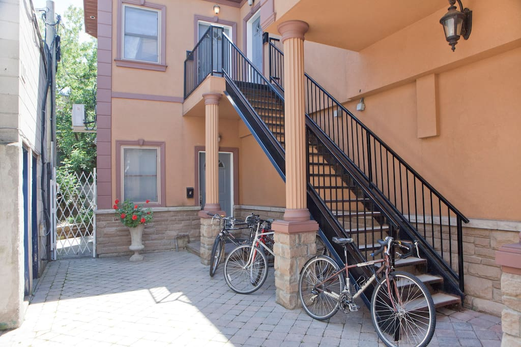 The outdoor staircase leads up to the apartment.