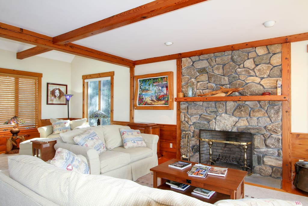 Warm up by the impressive floor-to-ceiling stone fireplace in the sunroom.