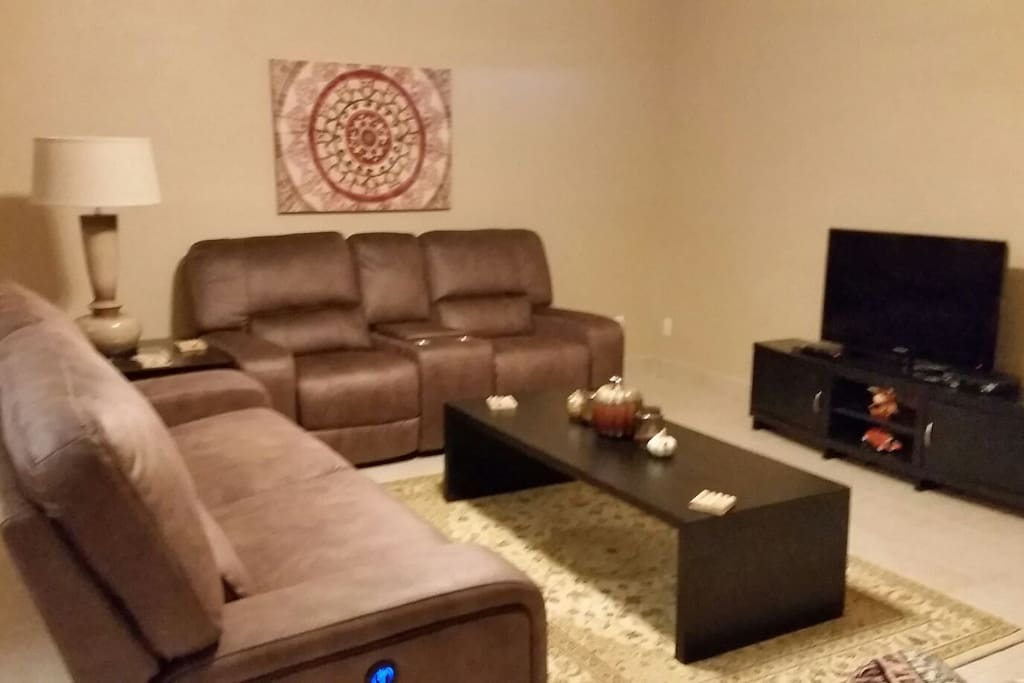 Living room with new reclining sofa and loveseat