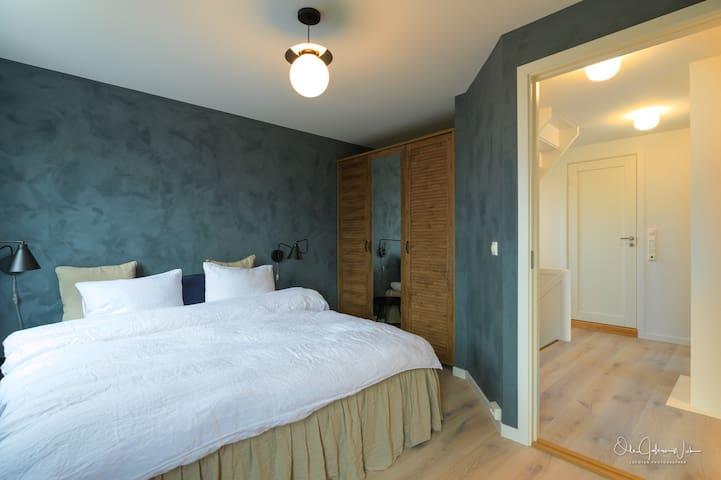 The blue master bedroom 1st floor