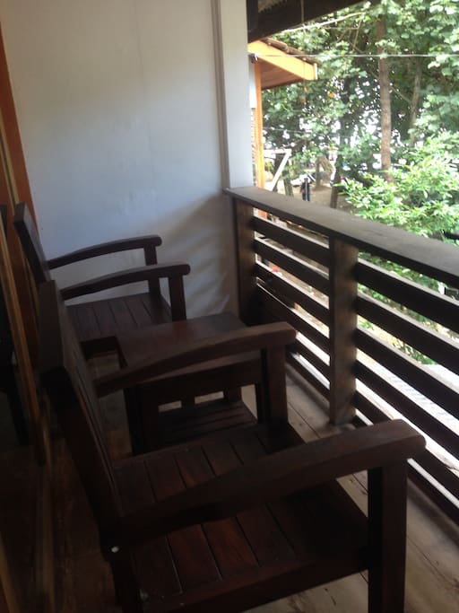 Balcony with teak chairs and table