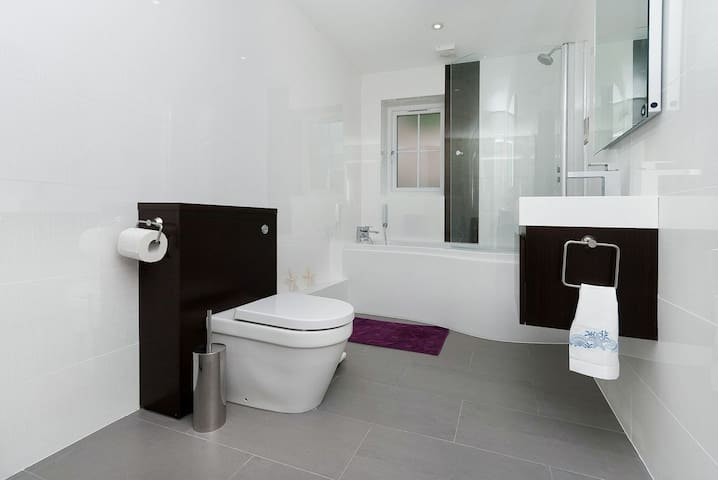 Not nearly as drab as it looks in this picture, the en-suite is spacious and well-equipped.