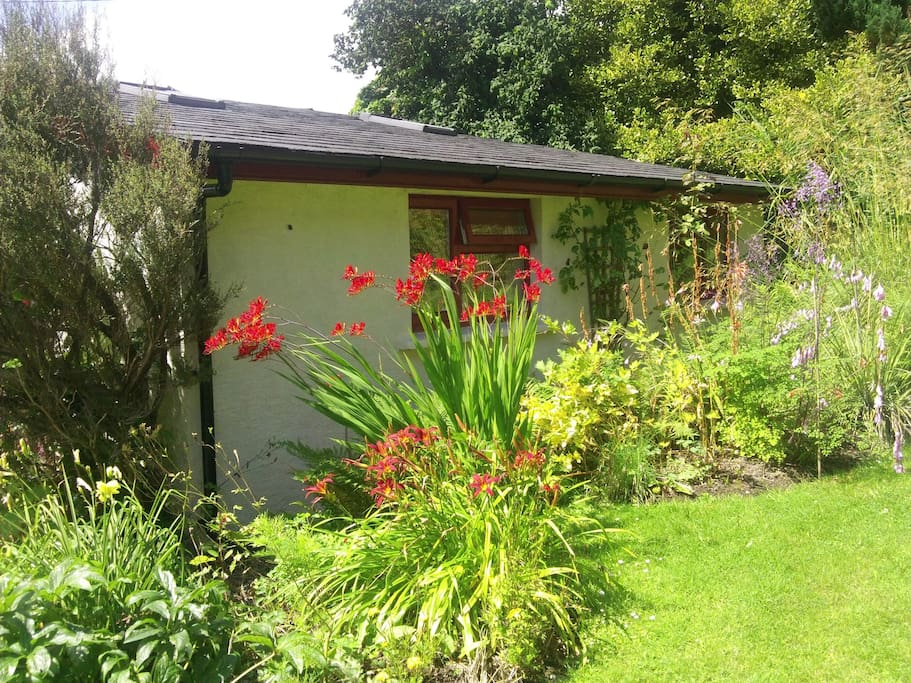 set in secluded garden ideal private space yet can walk to town.