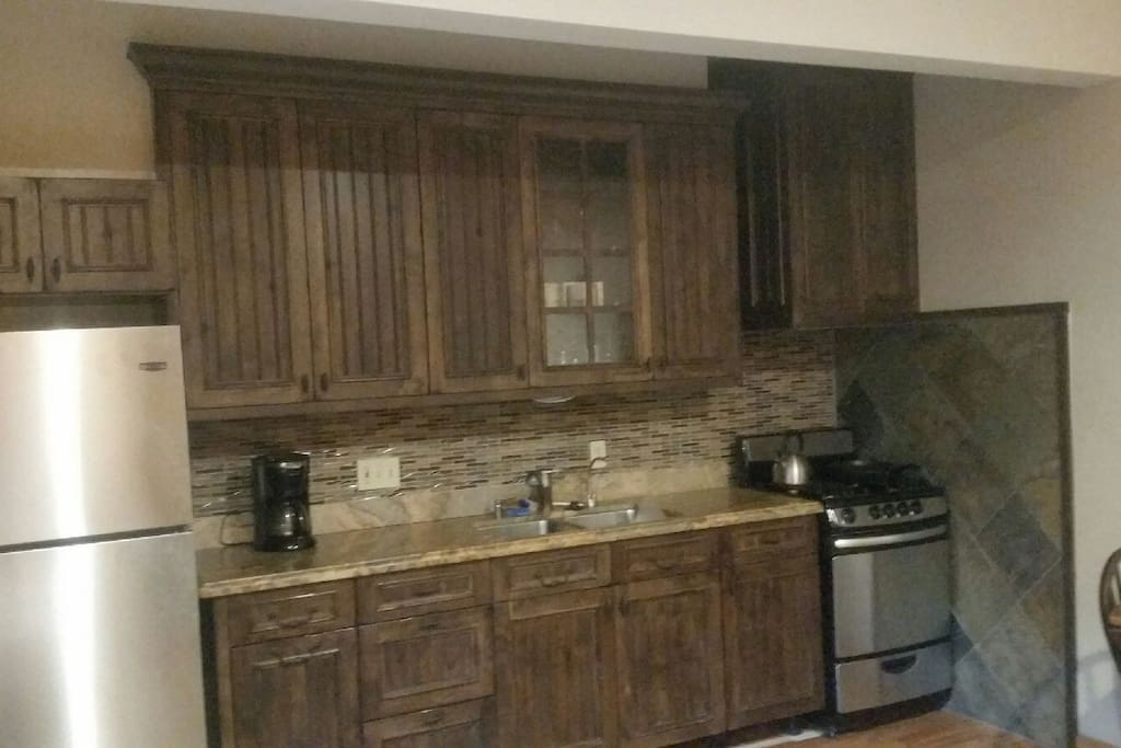 Remodeled kitchen with granite counter top stainless appliance, lots of lighting, fully equipped