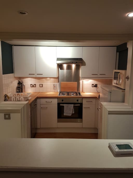 The kitchen, including gas hob, electric oven, dishwasher, microwave and fridge freezer