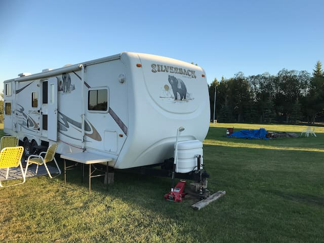 RV/camper trailer on acreage 5 km N of Sylvan Lake